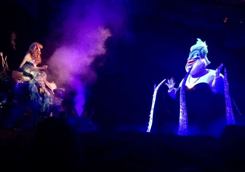 Ariel and Ursula on stage during a performance of Voyage of the Little Mermaid at Walt Disney World