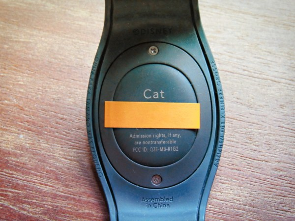 Back of a MagicBand, showing off personalization and code