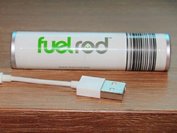 Fuelrod sitting on a desk with its included adapter