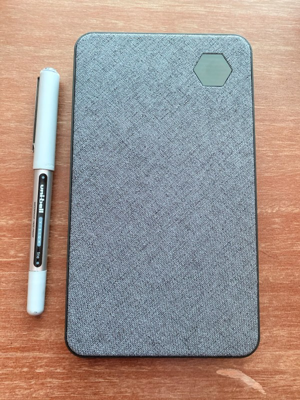 The Eggtronic Laptop Power Bank next to a pen, to show scale