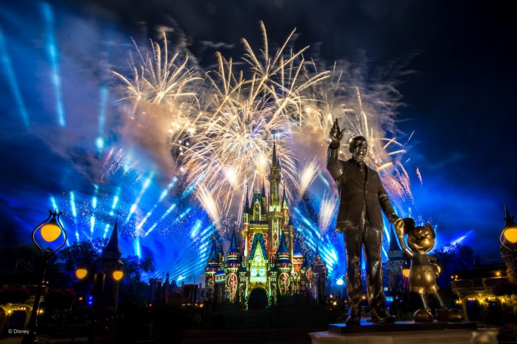 The Magic Kingdom Hub, featuring fireworks and the Partner Statue