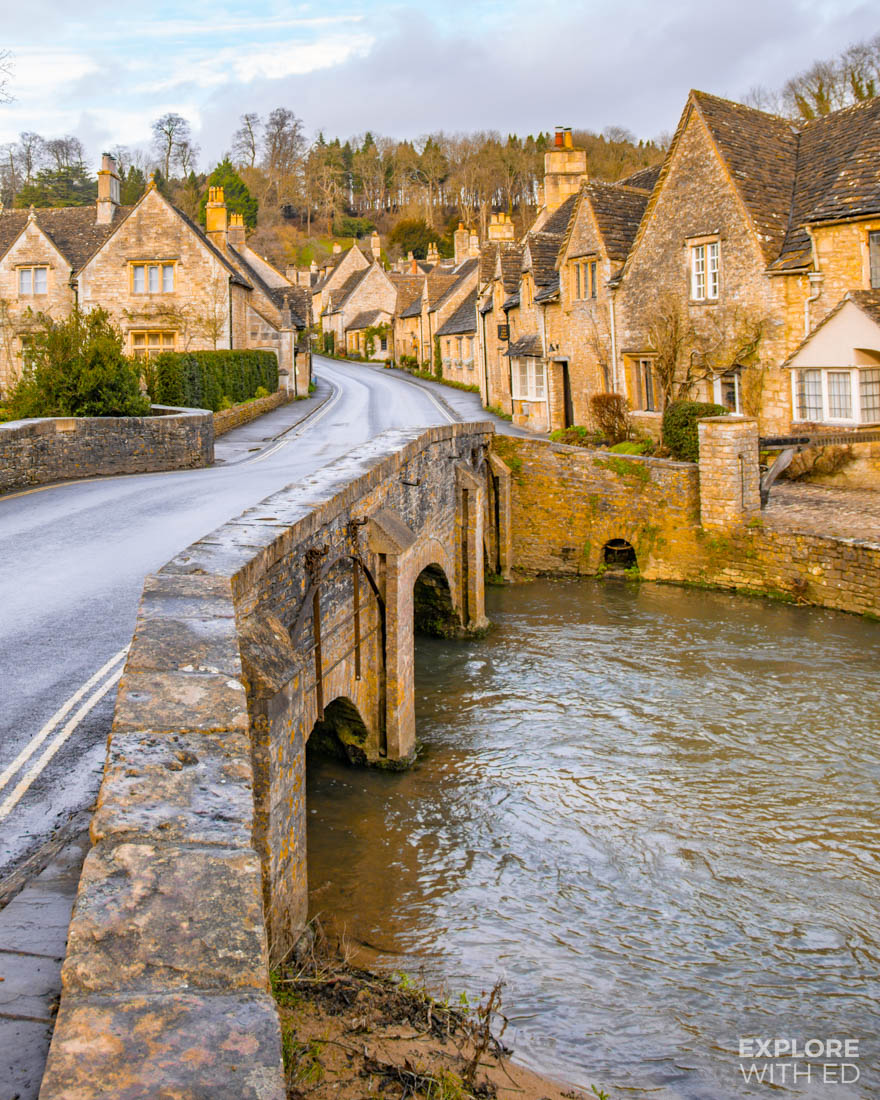 The classic view of England's prettiest village Castle Combe (in The Cotswolds) from the river bridge