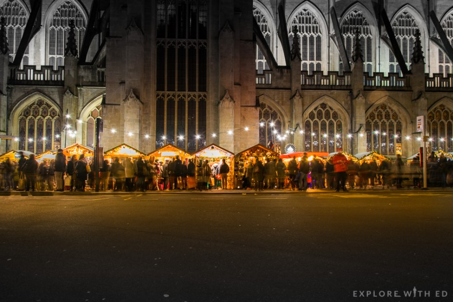 Bath Christmas Market at night besides Bath Abbey
