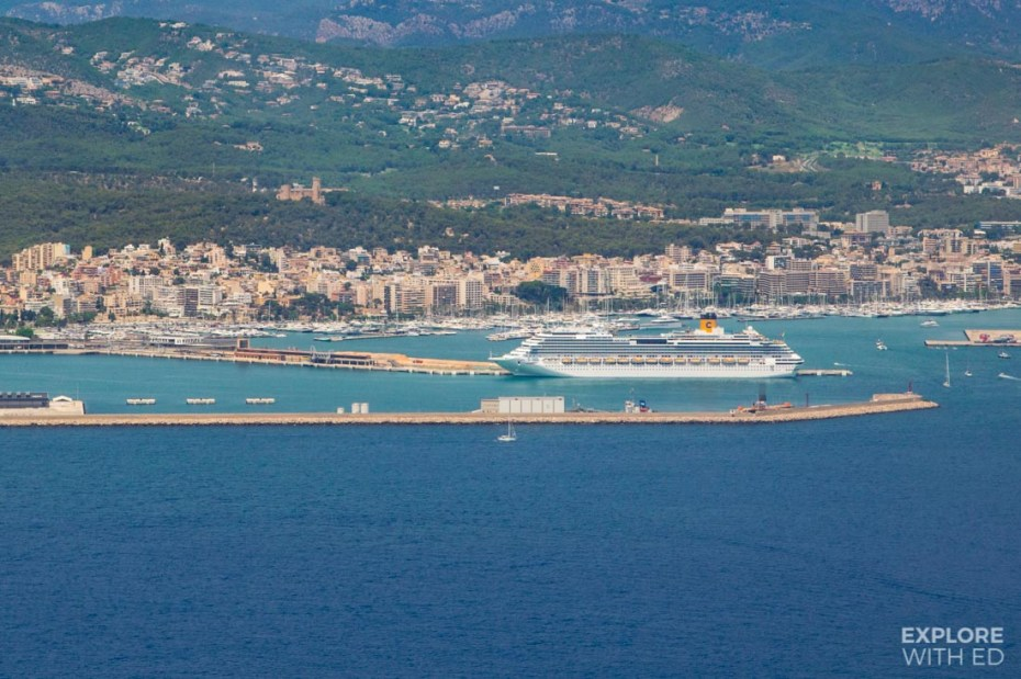 Costa cruise ship docked in Palma overlooked by Bellver Castle