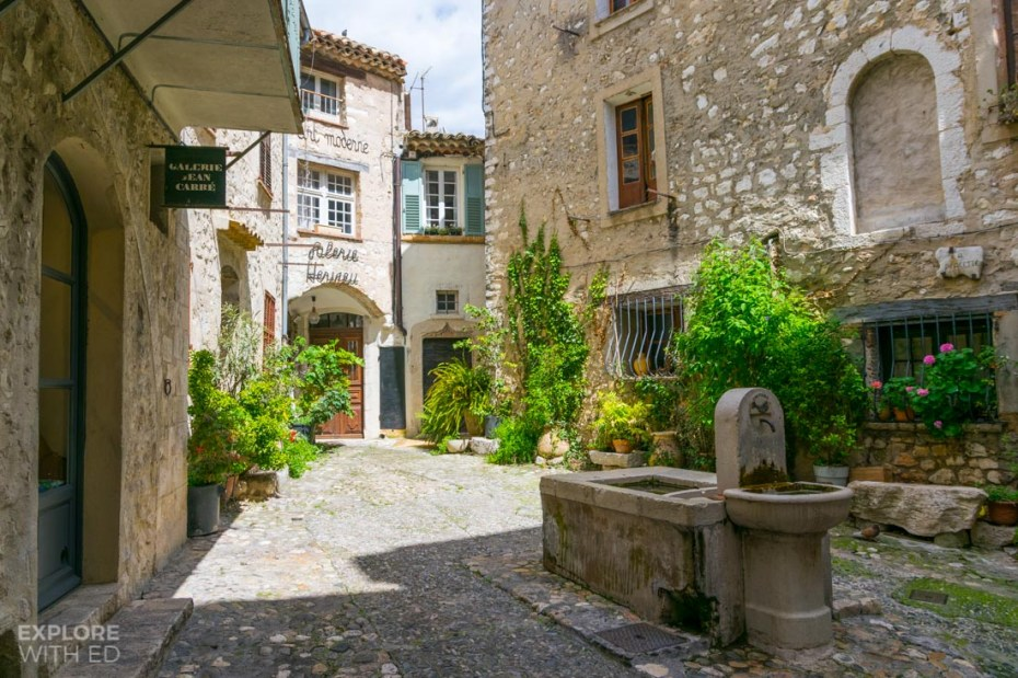 Quaint cobble stone square with fountain in Saint Paul de Vence