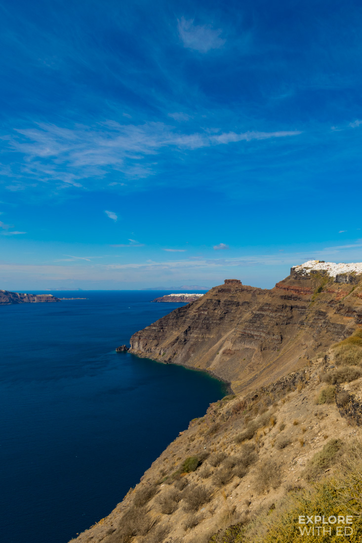The steep coastline of Santorini with the cliff top towns of Fira and Oia