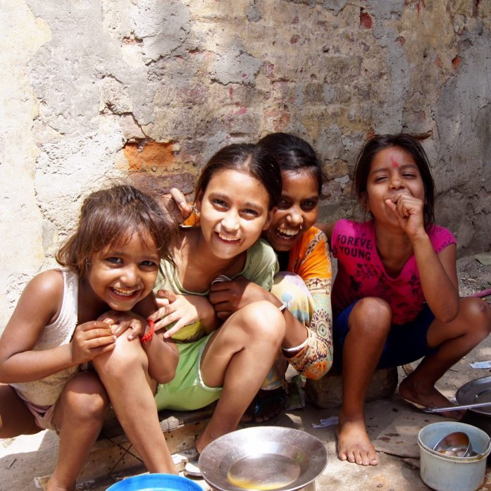 Delhi slum tour happy children