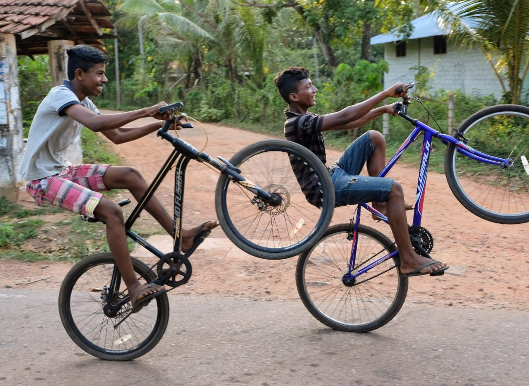Sri Lanka locals on bikes