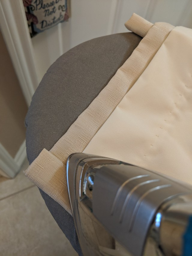 Press the stitched sides with dry synthetic heat setting