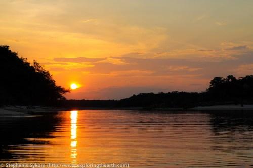 Sunset amazon river brazil jungle rainforest urubu piranha sunsets adventure travel boat South America