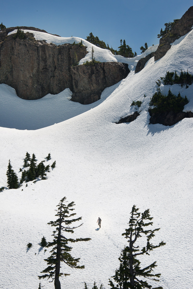 Phil all alone on the snow filled cirque below the ridge, on our way to High Rigger Mountain