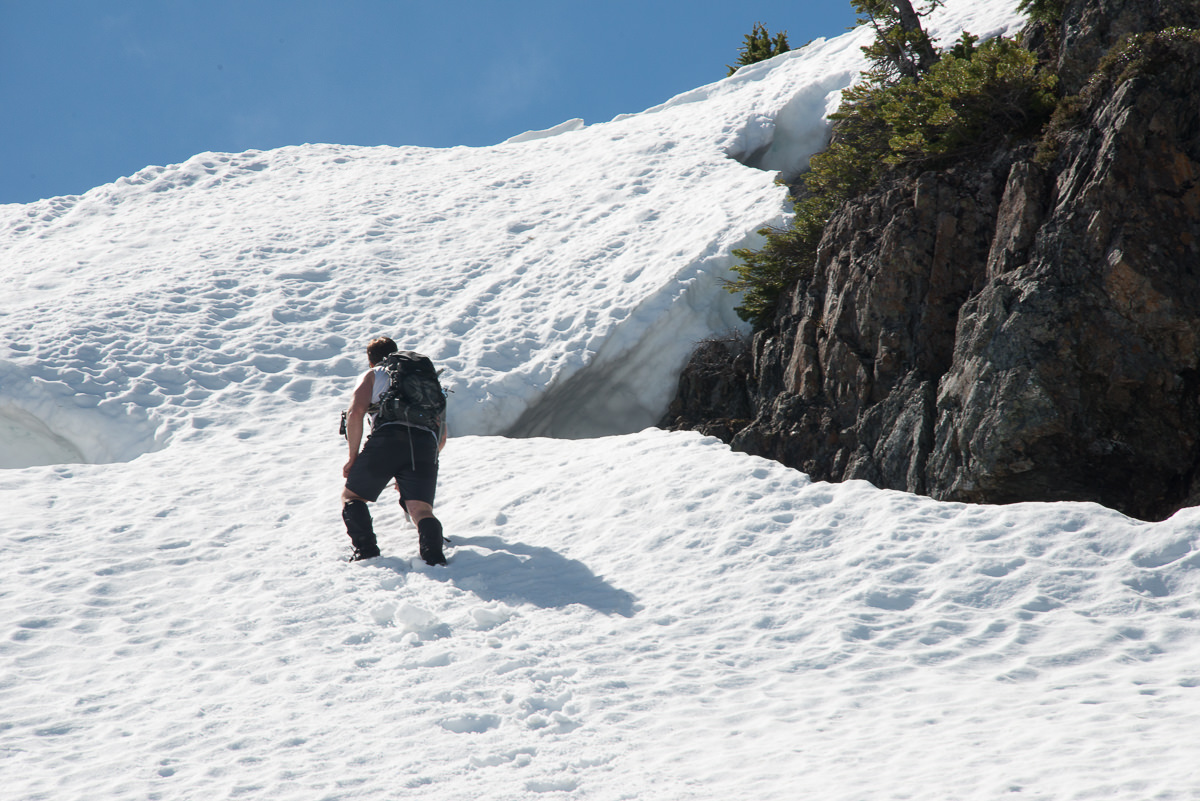 Phil on the steep snow, leading to the long ridge below High Rigger Mountain.