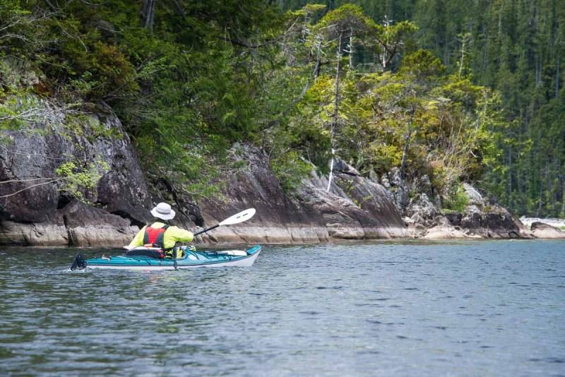 Michael paddling around Agnes Island, Kennedy Lake