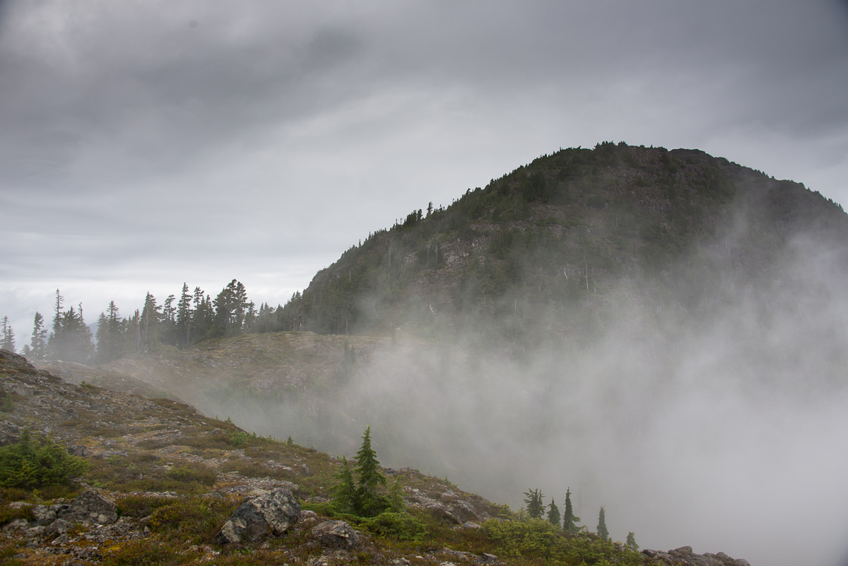 The summit emerges through this mists.