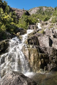 The many cascading waterfalls on the route up to the lake below Triple Peak.