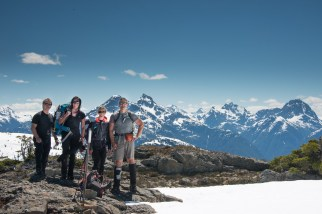 group of hikers on the summit of an unnamed bump