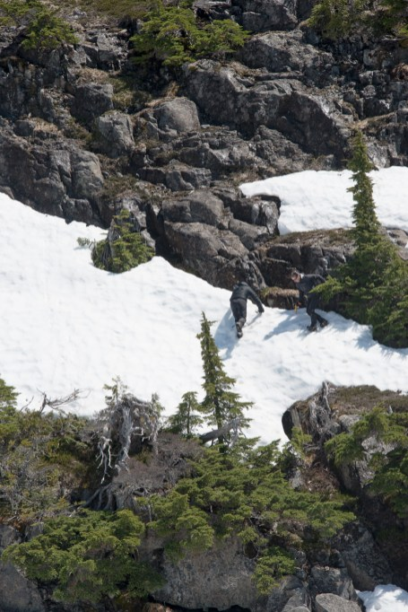 Rick & Colleen descend an icy section of rocks and snow, descending from our hike to Mount Heber in Strathcona Park