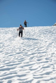 Rick and Colleen desending steep snow on the trip from Big Interior Mountain in Strathcona Park