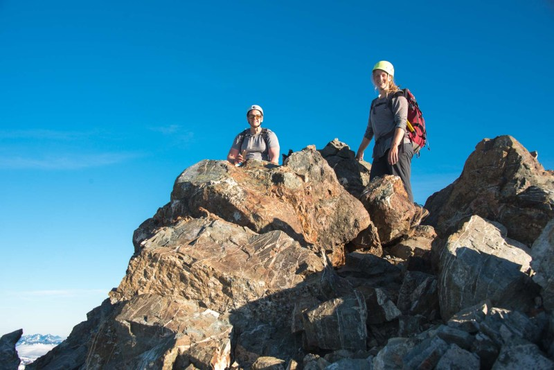 two mountaineers on the summit of this iconic Strathcona Park peaka