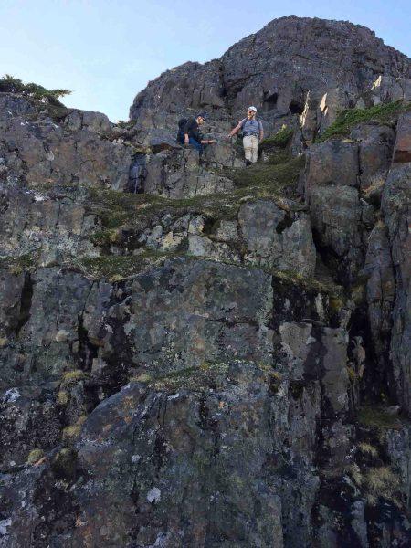 two men hiking down the Tsitika MOuntain