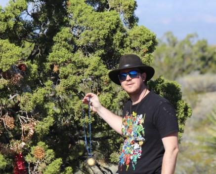 Kris hanging a Christmas Ornament