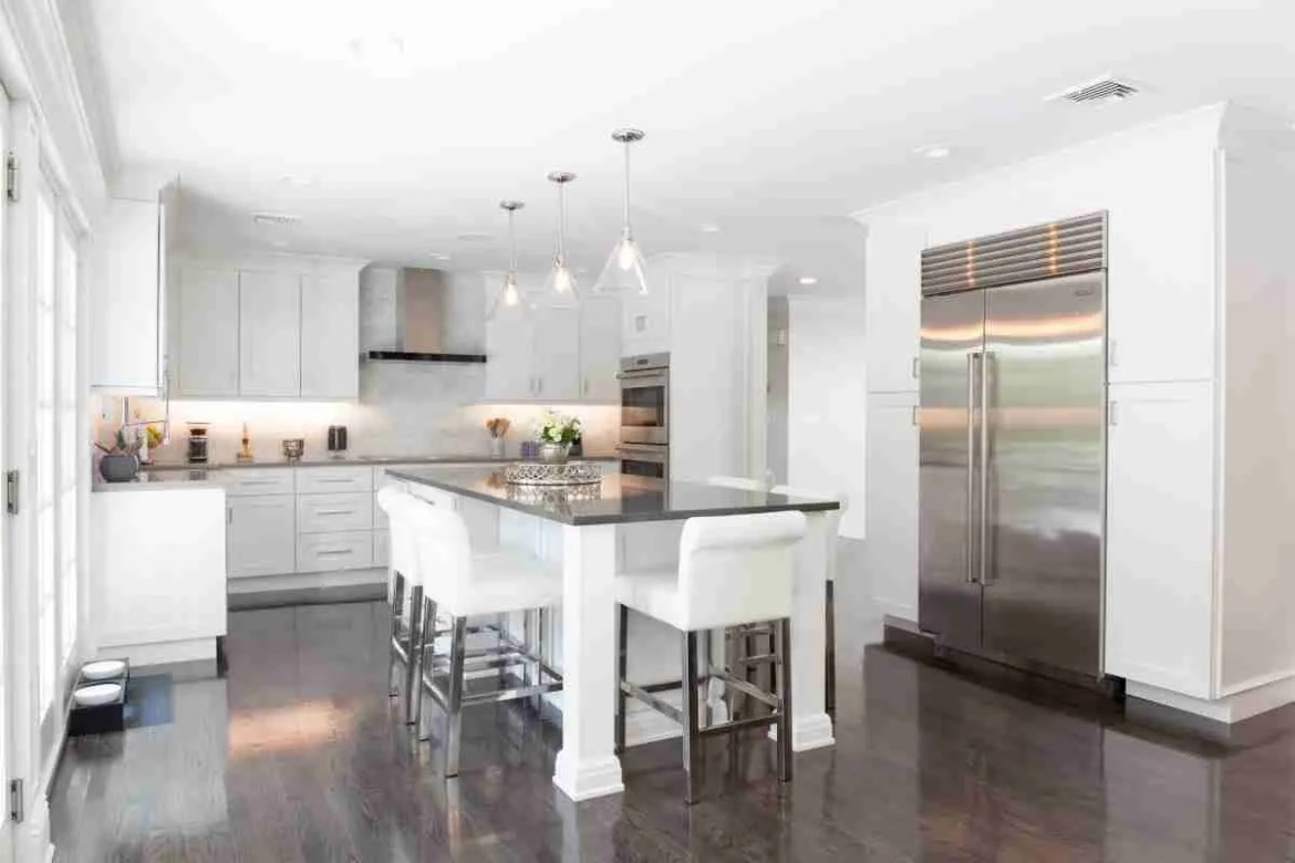 J&K Cabinetry White Kitchen with Large View