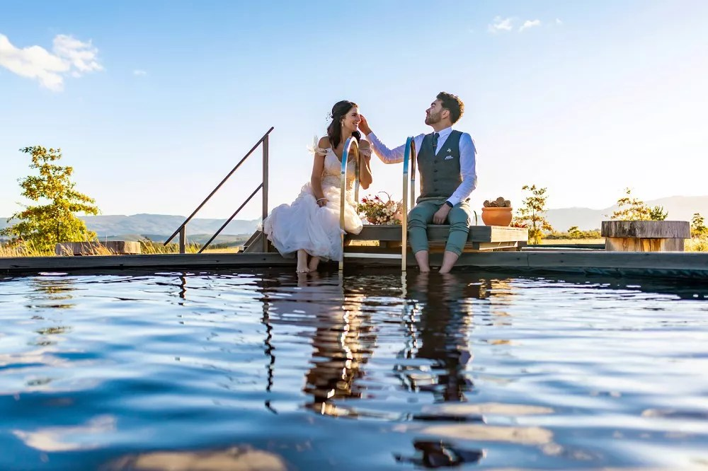 Cherry Glamping weddign bride and groom swimming pool