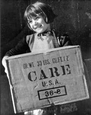 Regine Binet of Bayeux, France, a town not far from the Normandy invasion beaches, receives a CARE Package in 1946, a gift from an American she had never met.