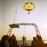 Parasailing boat sunset