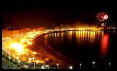 solsticio de verano salto de hoguera pisar sobre brasas bañarse en la playa San Juan