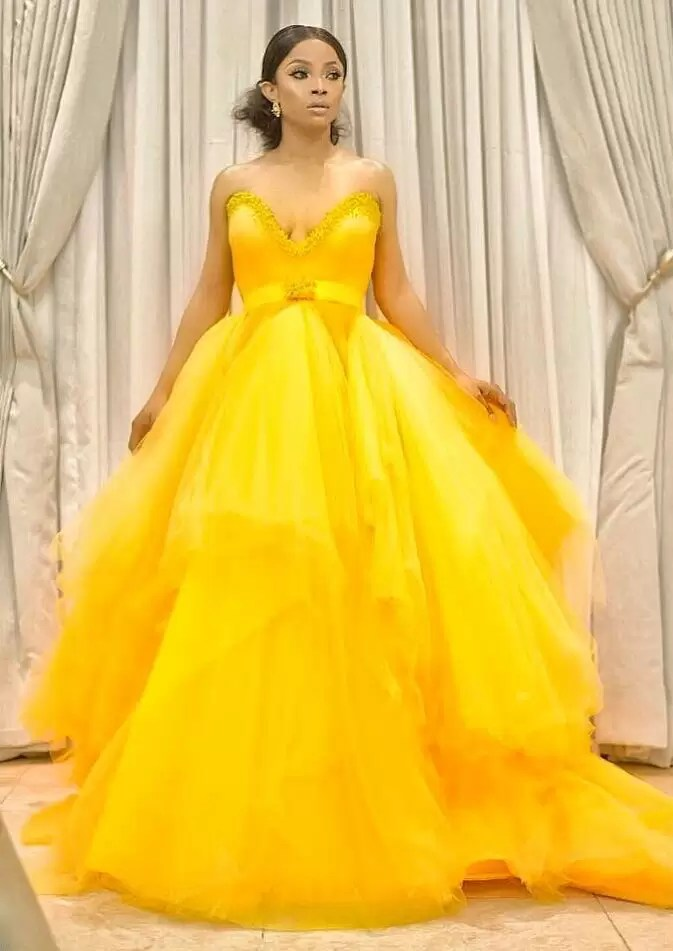 Toke Makinwa looking sharp and pretty in a Gert-Johan Coetzee sun yellow dress 2