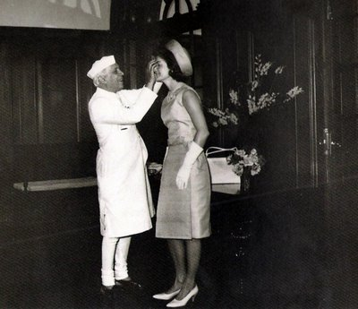 Jacqueline Kennedy with Pandit Nehru getting a tilak on exshoesme.com.