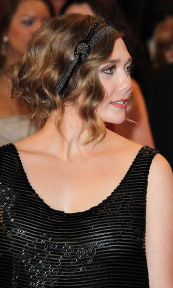 Elizabeth Olsen at 2011 Cannes Film Festival wearing The Row on exshoesme.com.