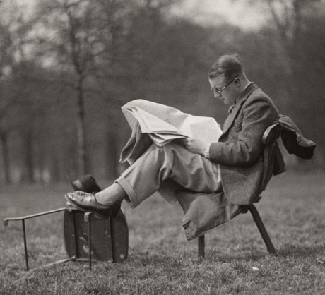 Man reading at lunch time, Hyde Park, London, 1934 by E. O. Hoppe on exshoesme.com