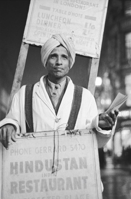 Sandwich board man advertising Shafi Hindustan Restaurant, 18 Gerrard Street, London by E.O. Hoppé on exshoesme.com