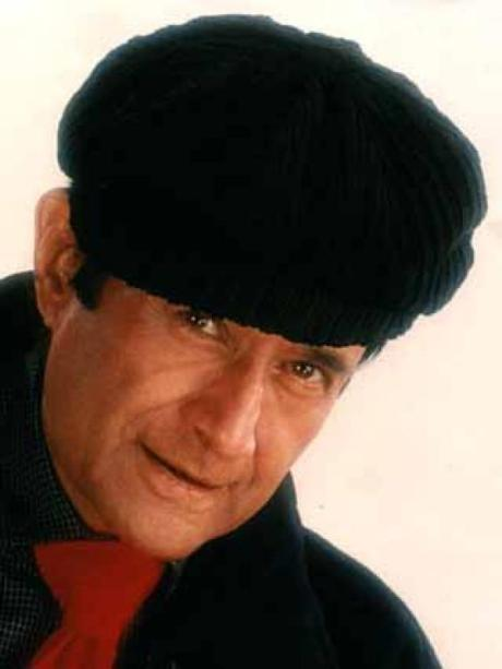 Dev Anand in newsboy cap and wide tie on Exshoesme.com