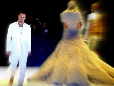 File photo shows McQueen walking on the catwalk at the end of his 2004-2005 Autumn/Winter ready-to-wear fashion collection in Paris