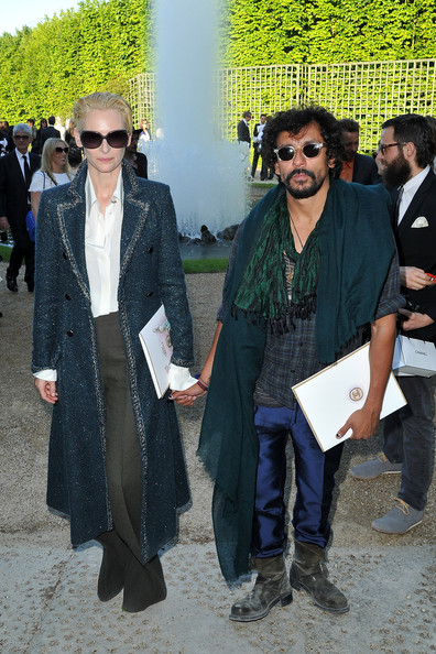 Tilda Swinton with Haider Ackermann at the Chanel 2012-13 Cruise Collection at Chateau de Versailles May 14 2012 on Exshoesme.com. Photo by Pascal Le Segretain