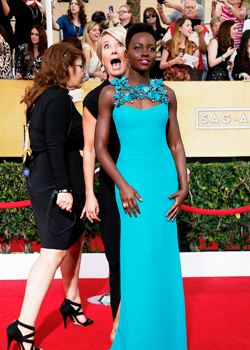 Lupita Nyong'o and Emma Thompson at the 2014 SAG Awards on Exshoesme.com. @shefinds photo