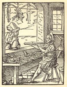 Een kruisboogmaker aan het werk in zijn atelier © Gravure uit 'Eygentliche Beschreibung aller Stände auf Erden', 1568. Deutsche Fotothek, Berlijn