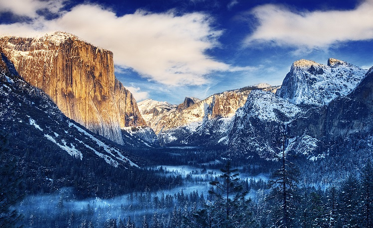 Sunrise over Yosemite Valley with snow capped mountains in early February.