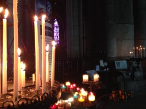 Lighting a candle in Reims Cathedral.