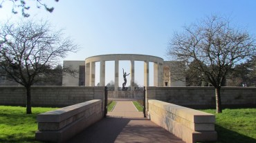 The colonnade with the massive bronze sculpture.