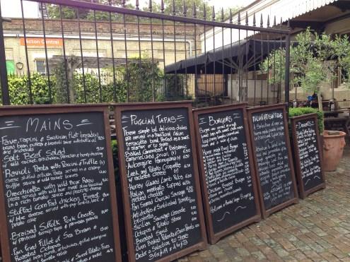 The chalkboard menus mounted outside.