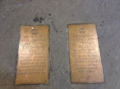 Plaques in the cement commemorating historic events.