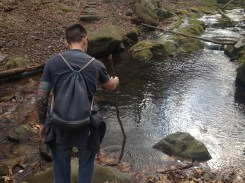 Testing the depth of the creek.