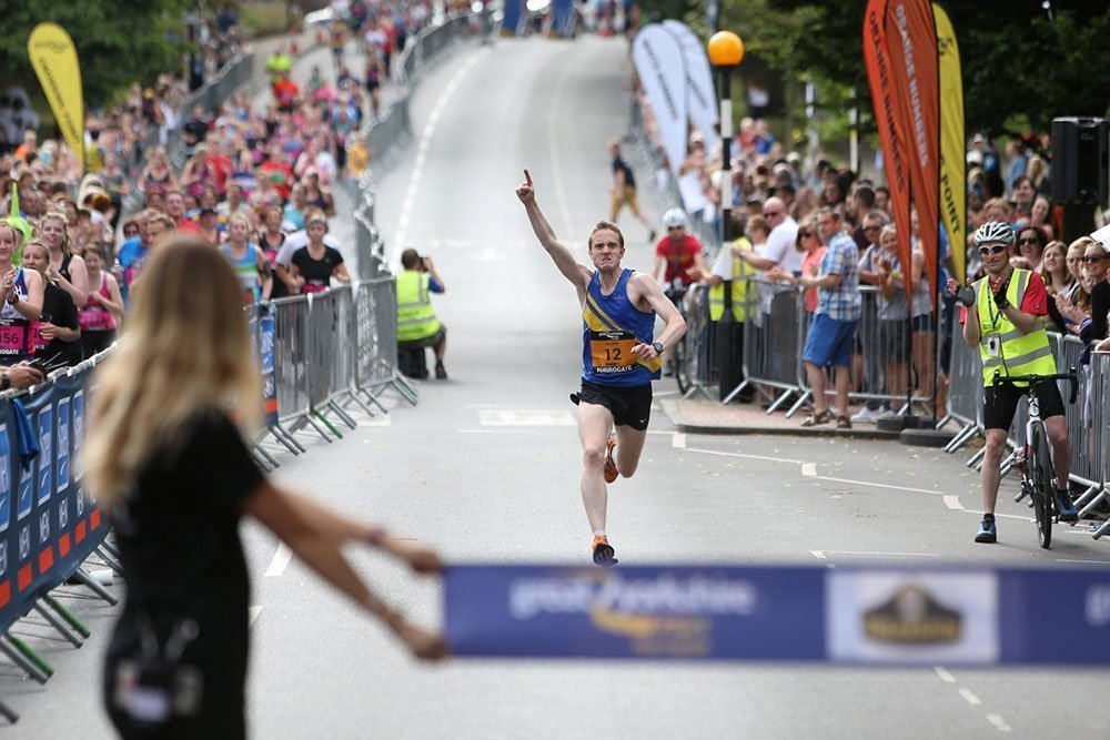 runner winning a marathon race, 1 arm in the air
