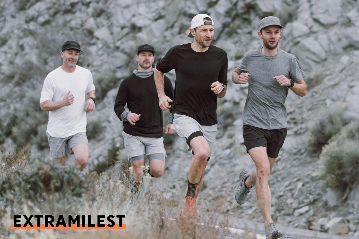 4 men running on the road in PATH projects clothing