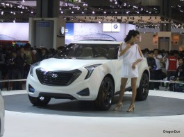 Seoul Motor show. A girl with every car!
