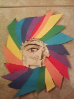 I drew an eye and had everyone add to it. It turned out looking like something from a dream world, so i added rainbows and made the figure stand out. It looks kind of like a cyclops.